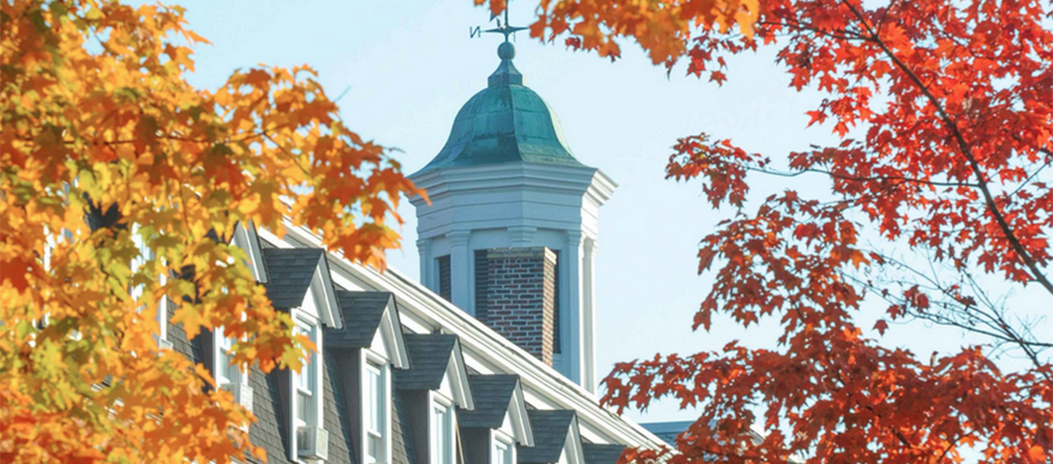 School's cupola surrounded by fall foliage