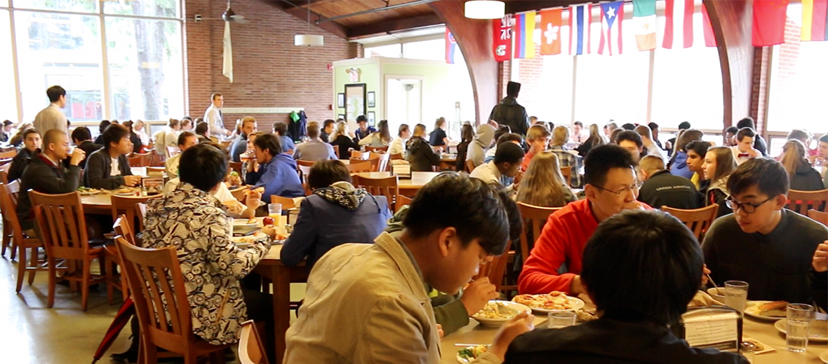 Dining hall full of students eating and talking
