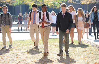 Students laughing and walking in a group