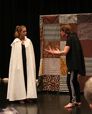 Two students performing Shakespeare.