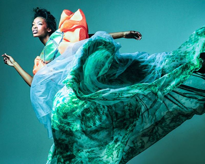 Artistic photo of flowing green dress.