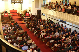 Aerial view of a Chapel filled with students and parents.